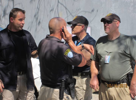a group of UN police conferring on how to handle a protest at the UN Logistics Base in Haiti. Photo by Marty Goodman/Socialist Action.