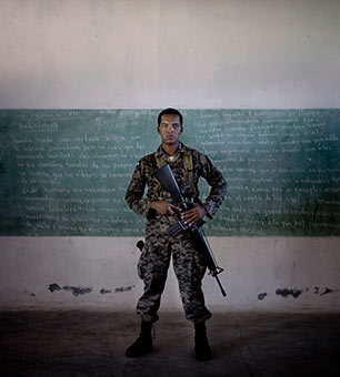 A Honduran soldier in a classroom at Forward Operating Base Mocoron, one of the three outposts from which they and Americans combat drug trafficking, in eastern Honduras, March 15, 2012. (Photo: Tomas Munita / The New York Times)