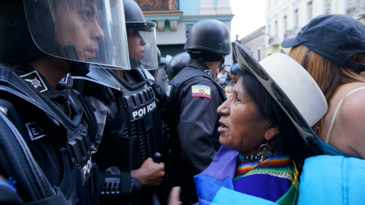 Carmen Lozano, President of the Women's Organization at ECUARUNARI, facing the police blockade at the August 27th march for the Yasuni in  Quito, Ecuador.