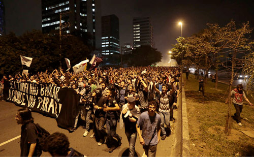 "Demonstration in São Paulo: ""If the fare do not goes down, the city will stop it!"" Photo courtesy of Crimethinc."
