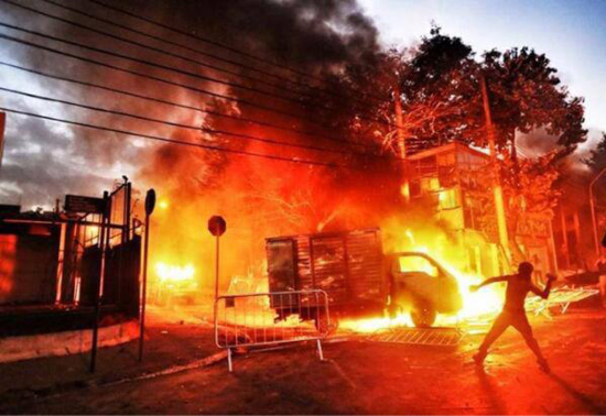 Car dealerships burning at a protest in Belo Horizonte on the day of the Confederations Cup game. Photo courtesy of Crimethinc.
