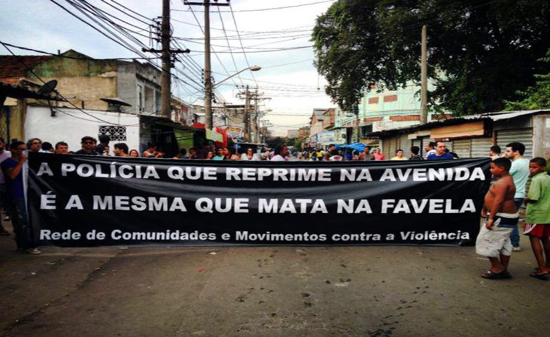 "Demonstration in Rio: ""The police that repress in the streets are the same ones that kill in the favelas!"" Photo courtesy of CrimethInc."