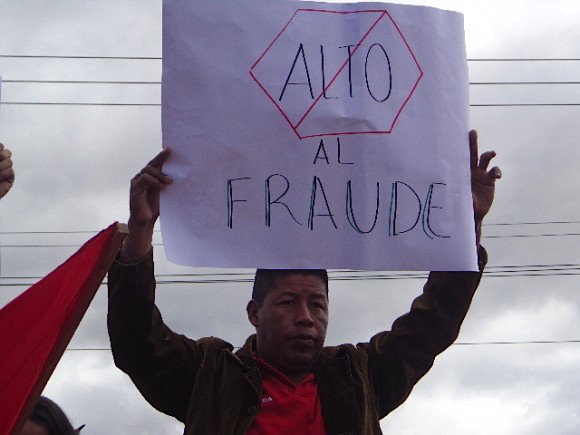 "Early on the morning of Sunday, December 1, people started gathering at the National Pedagogic University in Tegucigalpa with homemade signs to speak out against stealing of the presidential elections. This one reads ""Stop the Fraud."" Photo from www.SOAW.org"