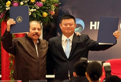 Daniel Ortega and Wang Jing