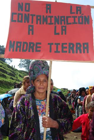 "Woman with placard: ""No to contamination of Mother Earth"", placard from the referendum in San Mateo Ixtatán, May, 21 2009."