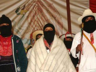 Zapatistas at anniversary celebration – Photo: Janet Schwartz