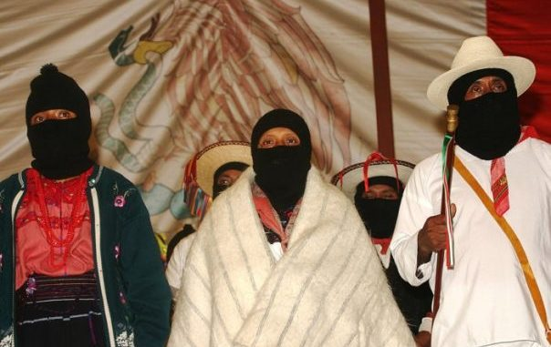 Zapatistas at anniversary celebration – Photo: Janet Schwartz